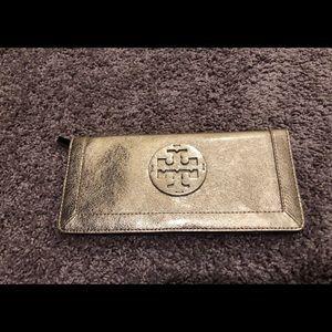 Tory Burch metallic gold clutch